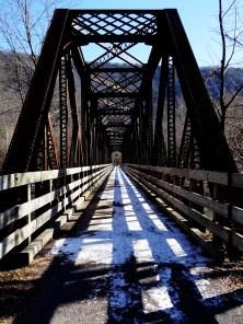 Steel truss bridge spanning Pine Creek south of Ramsey.