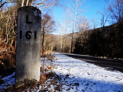 This New York Central Railroad marker is 161 miles from Lyons, New York.