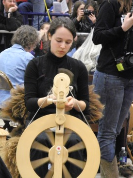 Molly concentrates on her spinning.