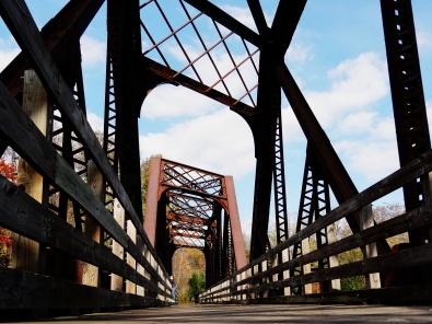 Steel truss railroad bridge.