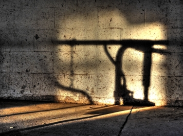 Stanchion in shadow.