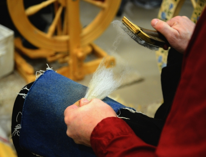... which opens the wool fibers and prepares them for spinning.